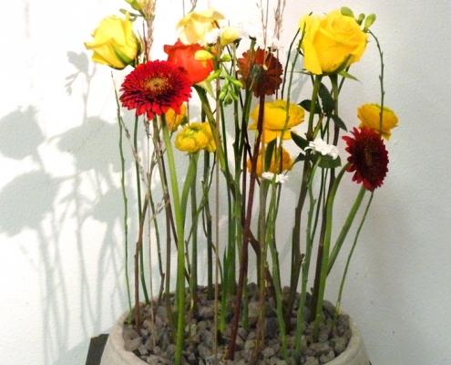 Parallelgesteck - bei diesem Blumengesteck werden mindestens 60 % des Werkstoffes parallel gesteckt.